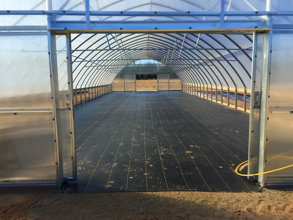 One of the new Thermolator 30 greenhouses, just built and ready for planting.