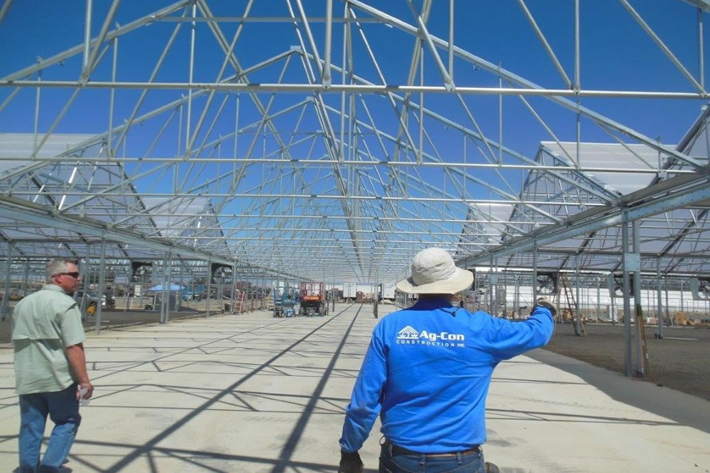 Ag Con foreman working with the customer | Commercial Greenhouse Manufacturer