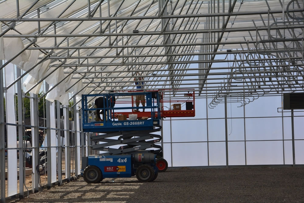 Ag Con Construction crew at work on the Shade Curtain | Agra Tech